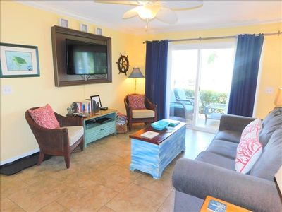 Photo for H13 Ocean Walk Resort, two bedroom, two bath downstairs condo on the park.  Close to clubhouse, front pool, and lake.  Also, overlooks a large park that has swings to enjoy the evening breezes.  King and two twins. Very clean and updated condo.
