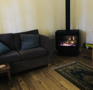 Snug up on winter eves next to the gas log fire