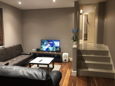 Photo for Open Plan Garden Apartment with Parking near Cafe Shops and Park