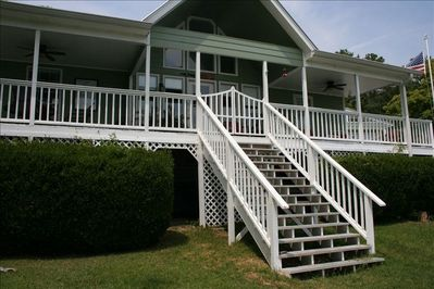House facing water, Covered porch with ceiling fans