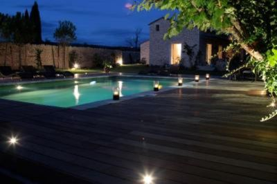 Swimming pool and house at night
