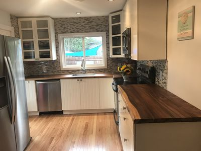 Photo for RENOVATED IN 2019-SLEEPS 12!! Can be split and rented as a 3/2 baths sleeping 9