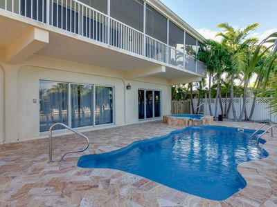 Photo for Lovely canal-front home w/ shared pool, hot tub - ocean nearby