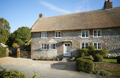 Photo for Thatched and built of stone, Coombe Cottage is a stylishly refurbished small Grade II listed cottage