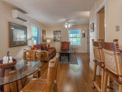 Photo for Two-level dog-friendly cottage w/shared pool, outdoor shower - near the beach