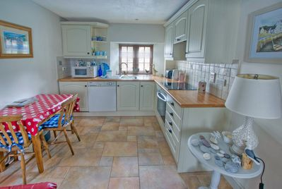 Kitchen area with dining table and chairs