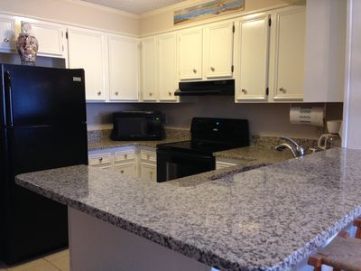 Fully furnished kitchen updated with granite counter tops Fall 2015.