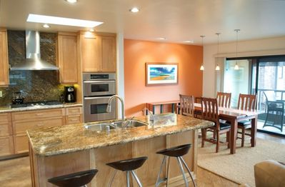 Professional, open kitchen is great for entertaining or hanging out with friends