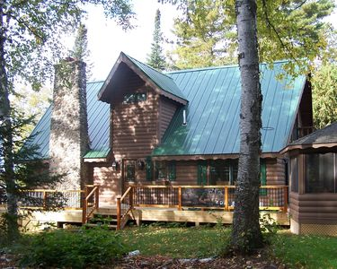 Peaceful setting, side view of our cabin with decking and gazebo.  The dormer houses the brand new bathroom for the loft.