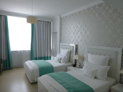 Photo for Spacious Twin Bed Serviced 1 Bedroom Apartment. Dubai Marina, end of JBR