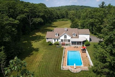 9 wooded acres, 4 acres manicured lawn,  6,800sf home, sleeps 10 comfortably