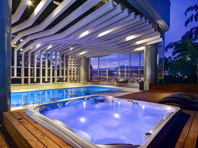 Photo for STUNNING PENTHOUSE WITH INDOOR HEATED POOL