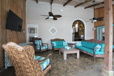 Relax outside in our covered deck with kitchen, large screen TV, DVD, & music.
