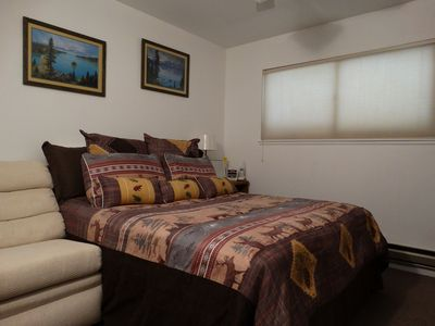 middle bedroom queen bed flat panel tv
