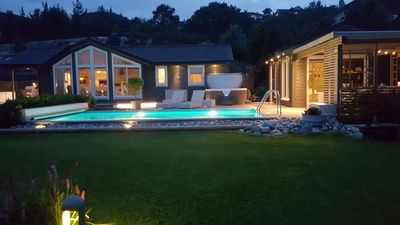 Photo for Holiday home in beautiful Strandvik, views of fjord and mountains, swimming pool and jacuzzi.