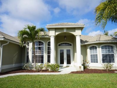 Photo for Lazy Daze - SW Cape Coral Waterfront Pool Home with electric heated pool and spa,