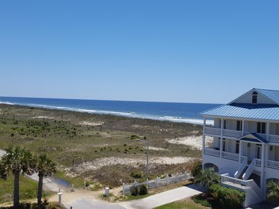 Photo for Beautiful 4 Bedroom top floor condo with spectacular view! Steps to the beach!