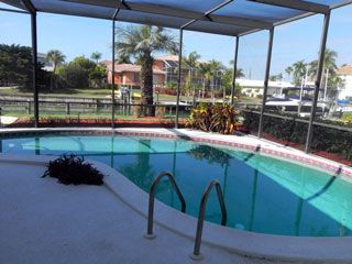 Photo for Charming 4 BR / 3 BA house with Screened in Pool,  Canal Front and a Fishing Dock