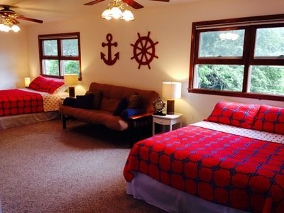 Captain Quarters with Two New Queen Mattresses and Futon
