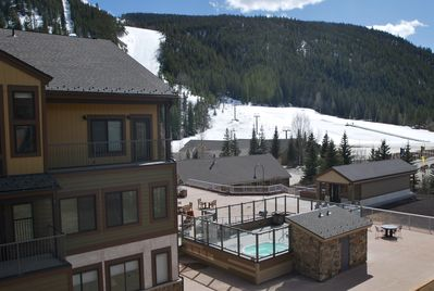 Views from condo & deck of ski school, slopes, hot tubs, fire pit, club house.