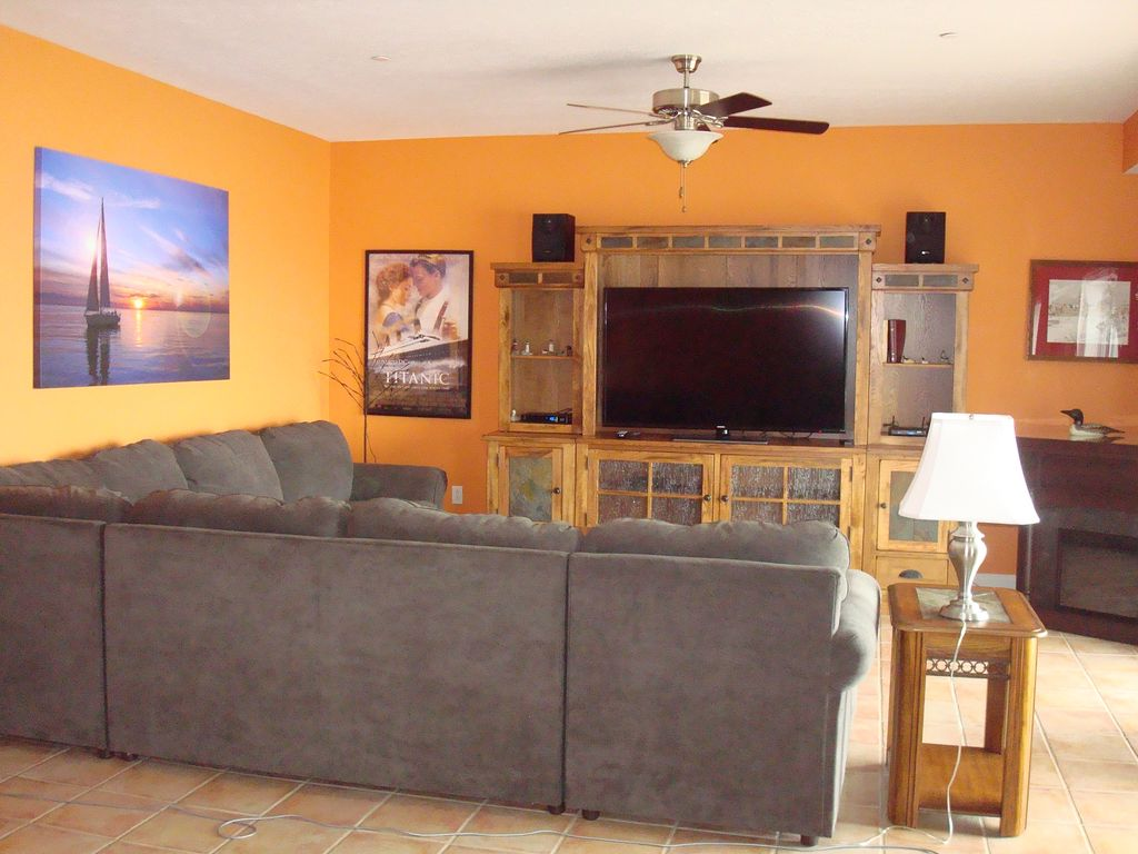 Living room with large sectional and entertainment center
