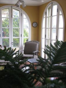 SPANISH STYLE SUN ROOM: Start your mornings in this cozy sun room