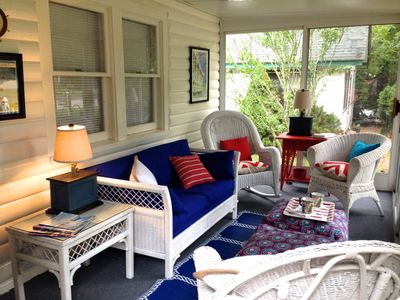 A perfect sunroom with sliding doors & screens on three sides