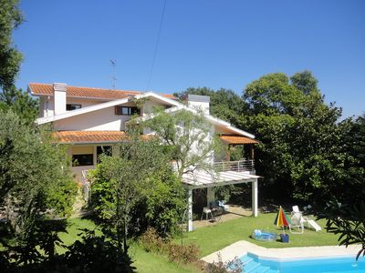 Photo for This 4-bedroom villa for up to 8 guests is located in Porto and has a private swimming pool, air-con