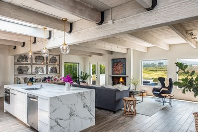 The kitchen feature a gigantic center isle with bar seating & magnificent views.