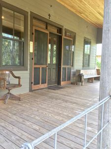 Front porch welcoming you. Handmade screen doors.