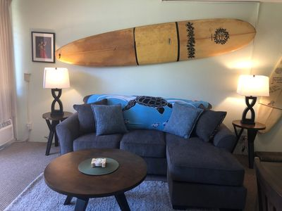 Brand new sofa bed with our signature surfboard wall