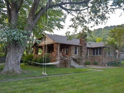 Photo for Charming Cottage with Swings, hammock, large fenced yard, and big trees