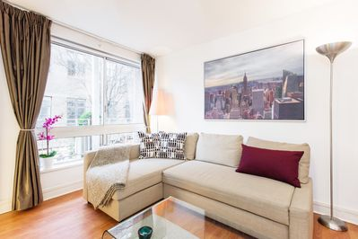 Large (covertible) sofa and large bright windows overlooking trendy Seven Dials
