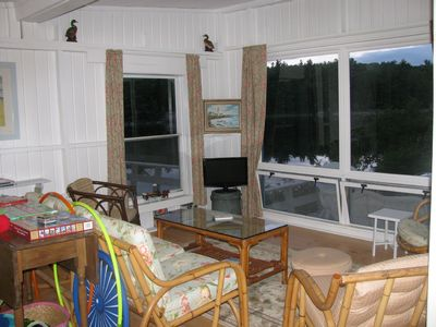 Living room overlooks deck and pond