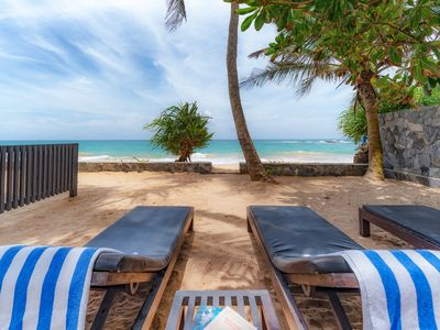 Photo for Red Parrot Beach Villa Right On The white sand beach