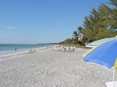 A real sandy beach...with beach chairs & towels. Unit w. partial ocean view