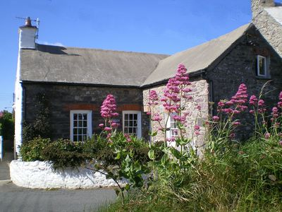 Photo for Old Stone cottage in heart of St Davids, private garden overlooks Cathedral