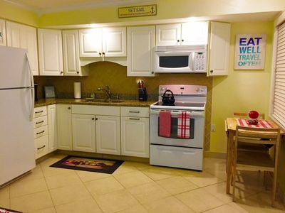 Full designer kitchen Flat top stove Granite counters expandable dinette set Wow