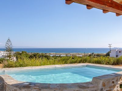 Photo for Natural stone cottage with private pool sea views