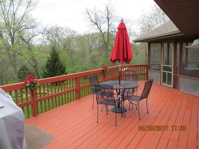 Deck, with view to backyard and screened-in porch.