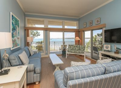 Living Room with Balcony Access and Water Views at 1883 Beachside Tennis