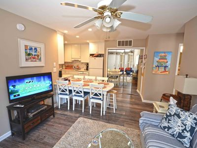 Photo for Cozy, traditional 2 bedroom bay side condo with WiFi, 2 pools, tennis, and HBO located in a family-friendly neighborhood and just two blocks from the beach!