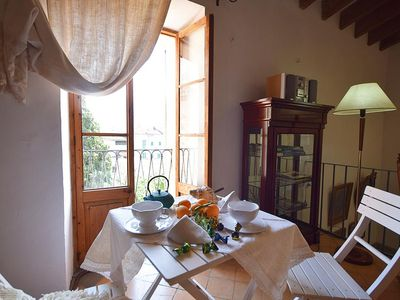 Photo for Centric town house with sunny patio and covered terrace in Soller