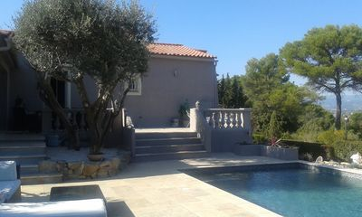 Photo for Quiet modern villa with views, olive trees, swimming pool