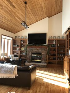 """Family room on main floor. 75"""" television."""