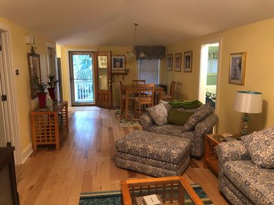 view of front door and dining area which is off the kitchen