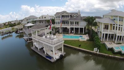 From a drone...Canal, Boathouse, Pool,  and back of house facing north