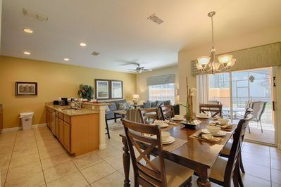 Open Floor Plan - Kitchen, Dining Area & Living Areas w/Pool Area View