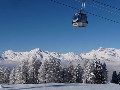 Photo for 4* Apartment with Stunning Views in Veysonnaz. WiFi. Best Skiing in 4 Valleys.