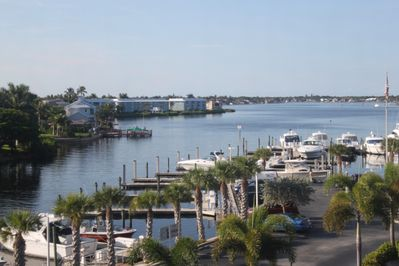 Located at the tip of Naples Island, this condo offers fabulous waterfront views